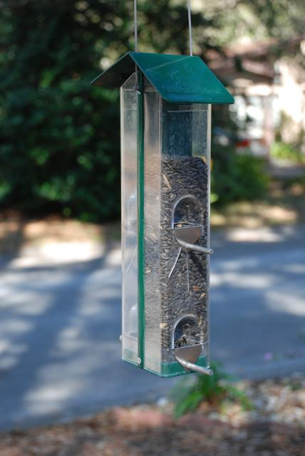 Figure 1.Tube feeders are typically comprised of a hollow cylinder, most commonly made of clear plastic or glass so the seed is clearly visible, with multiple feeding ports and perches.