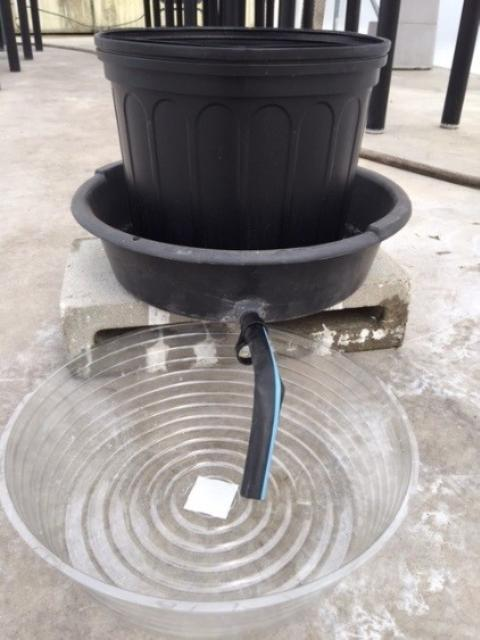 Figure 5.Using an oil pan drain to catch leachate.