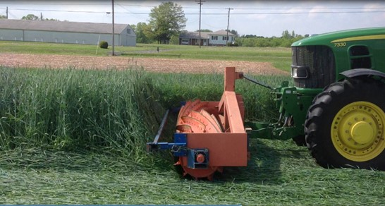 Figure 1. The roller-crimper rolling down a cereal rye cover crop in a no-till field.