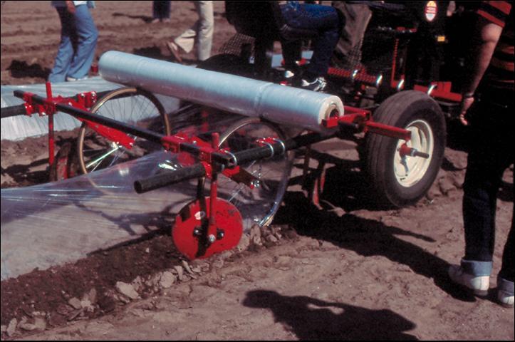 Figure 17.Mechanical row-cover applicator.