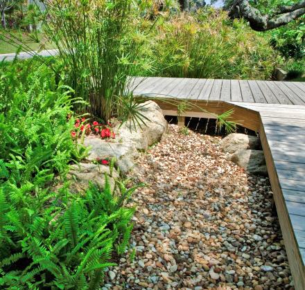 Figure 15.A wood boardwalk and gravel drain area add function and beauty.