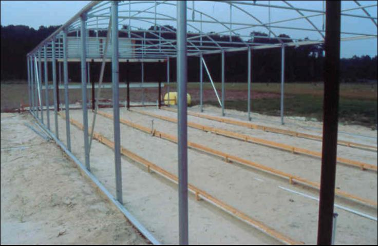 Figure 25.Installing greenhouse floor with leachate collection system.